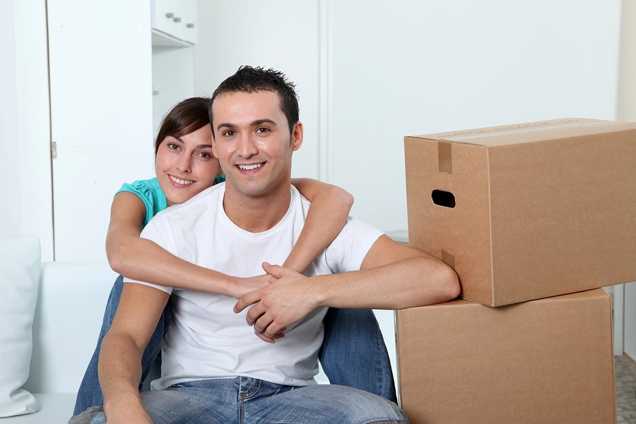 Young couple moving in new place